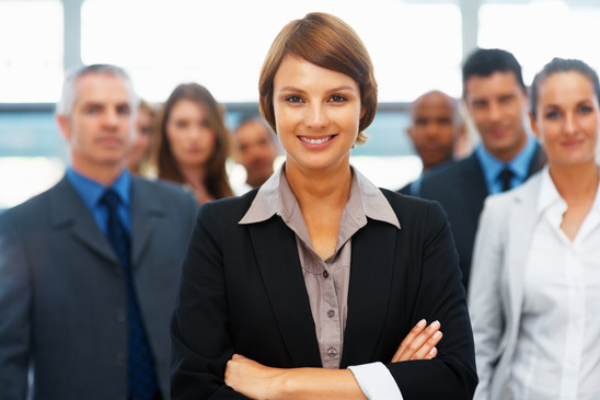 photodune-645134-businesswoman-with-colleagues-behind-her-xs (1)